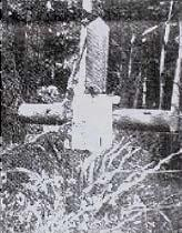 Simple cross that originally marked Bishop Sliwowsky's grave.