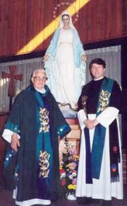 Fr. Bernard Reiser of Coon Rapids, MN, with Fr. Dan.  In 1995, Fr. Reiser donated to us a 1973 Rodgers electronic organ.  Only because of this organ has the parish in Vladivostok been able to make such progress in liturgical music development.