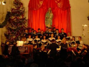 The Catholic Concert Choir of Vladivostok performs during the Christmas 2003 concert, along with the Regina Angelorum chamber orchestra.