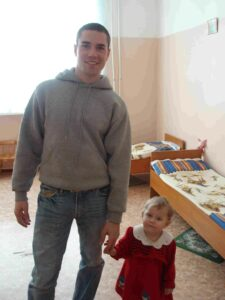 Brian, a volunteer in Vladivostok, visits with one of his friends at the orphanage.