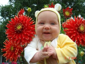 Six-month-old Eseniya enjoying the flowers, thanks to the WSC in Vladivostok.