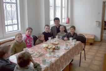 Fr. George Park, the first live-in pastor at Lesozovodsk, with some of the parish children.