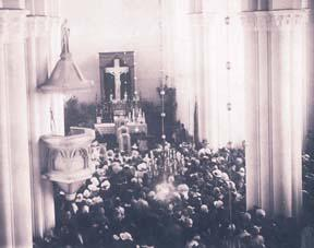 Interior of the new stone church, with the crucifix prominently displayed.  This photograph was discovered in 2001 in the archives of the Ursuline nuns in Krakow, Poland.
