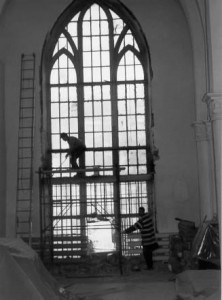Workmen removing the old windows.