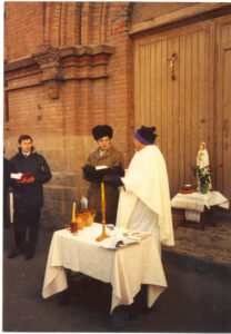Fr. Myron celebrating Mass at the church in Vladivostok.  The church building was still closed at the time, but the front steps were available.