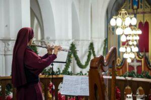 Sister Catherine Marie provides flute music for the Christmas Mass in Vladivostok.